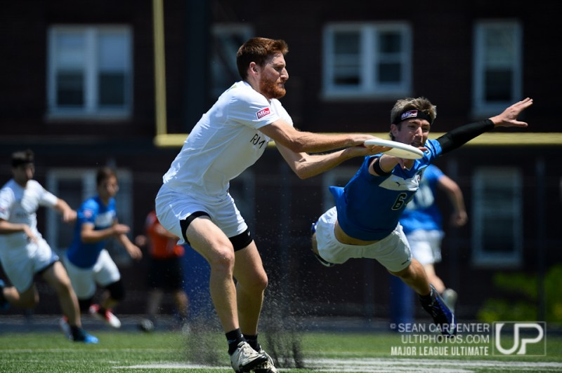 Union City, NJ: Michael Hennessy  (New York Rumble #4) makes a catch as Frederik Brasz (Philadelphia Spinners #64) defends at the Major League Ultimate game between the New York Rumble and Philadelphia Spinners, Sunday May 8 2014.